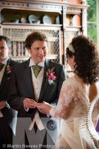 D2288-070-the groom_puts_ring_on his_brides_finger_at_Prestwold_Hall