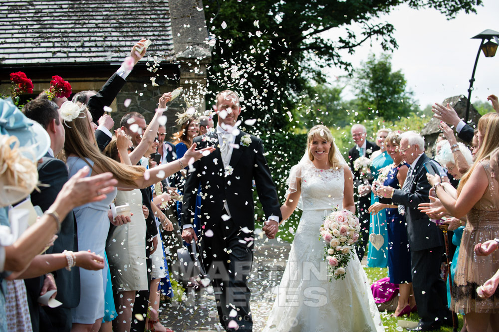 Wedding guests throwing confetti.