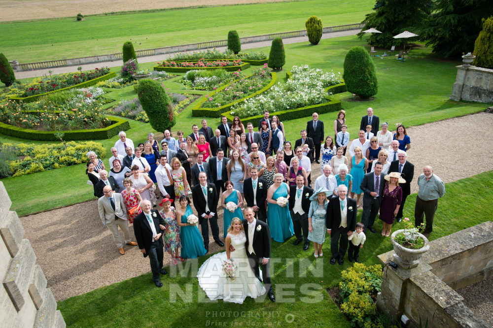 Aerial group shot of all the wedding guests in the grounds of Prestwold Hall in Leicestershire.