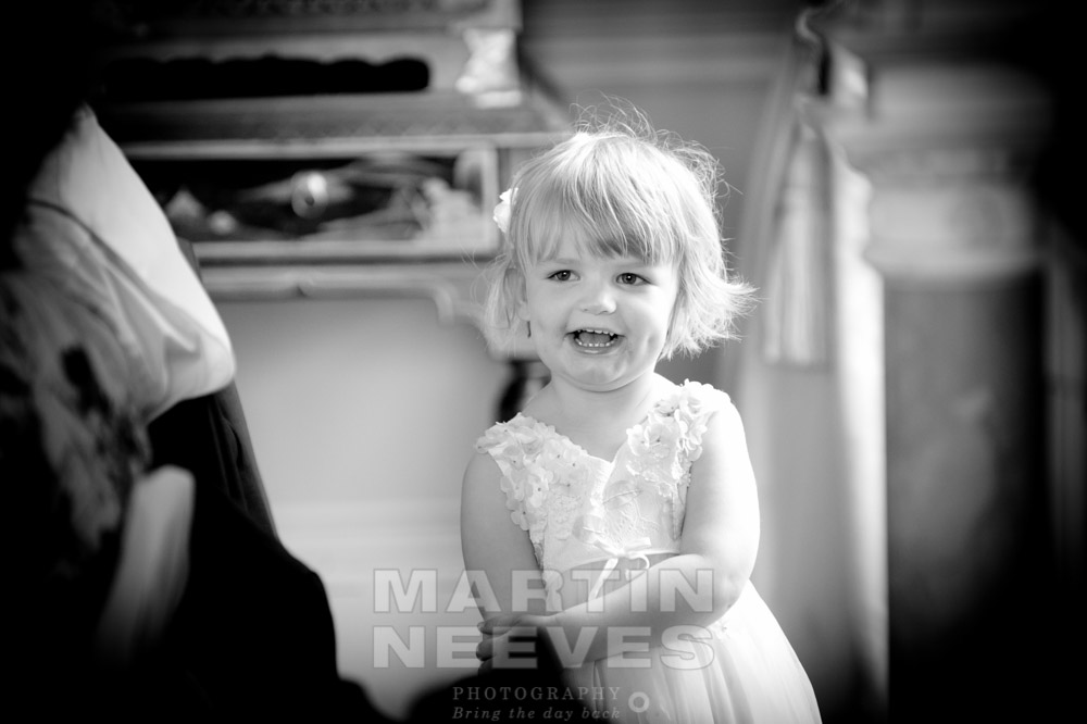 A cute child smiles during the wedding reception.