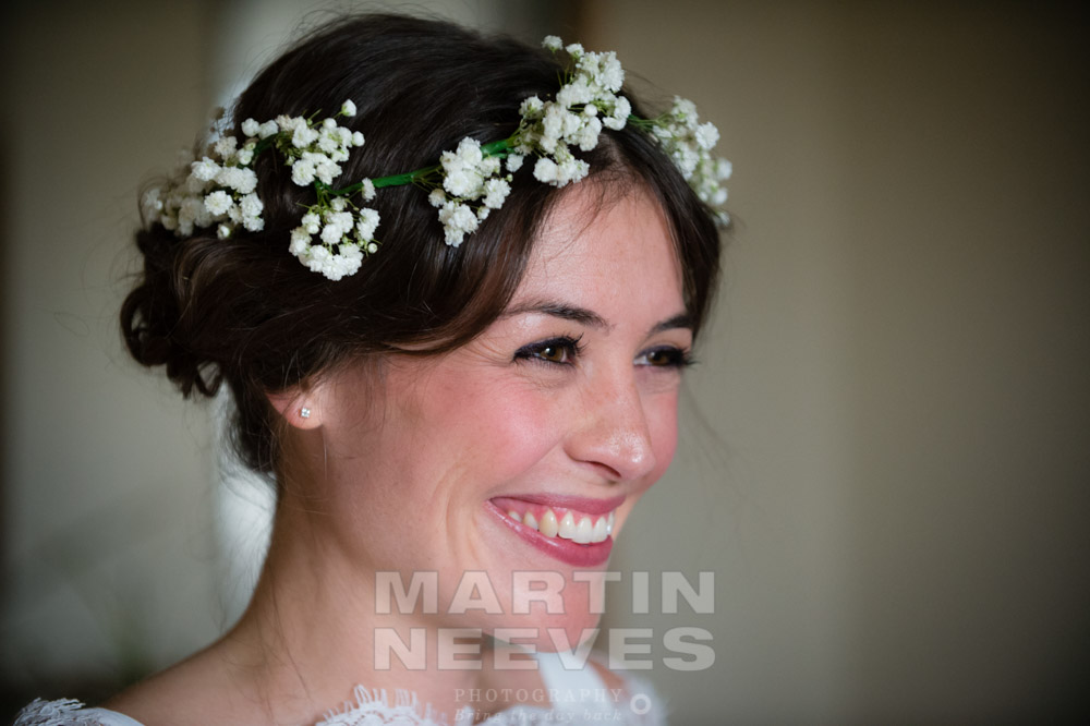 A portrait of a very smiley bride before the ceremony.