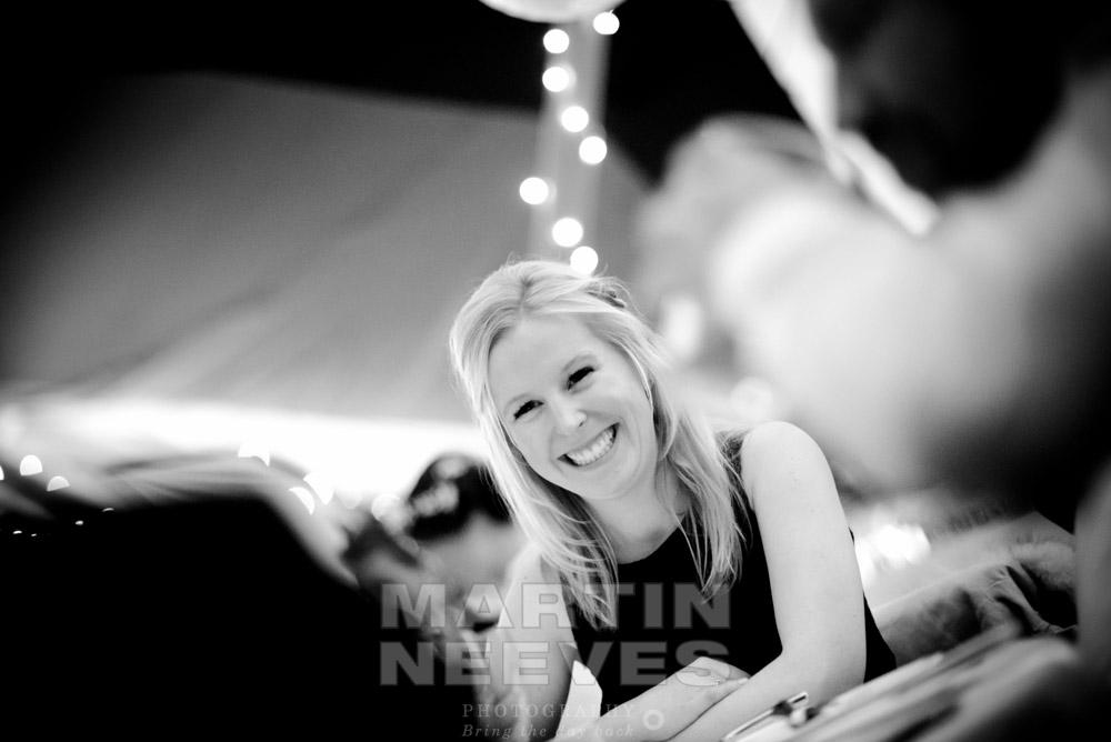 A bridesmaid enjoying the tipi wedding reception.