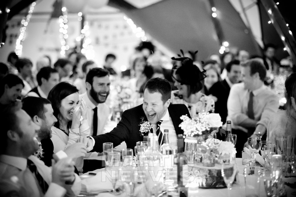Fun and laughter among the wedding guests in the tipi.