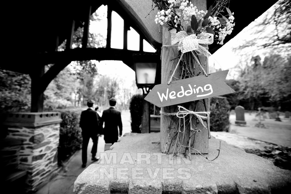 A sign pointing guests in the direction of the wedding ceremony.