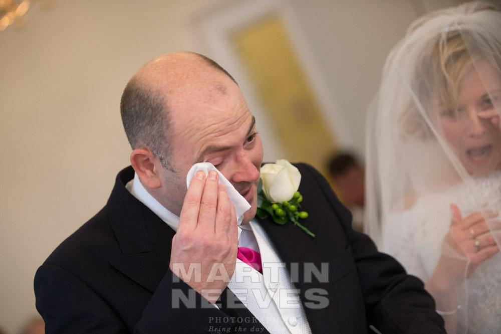 The groom wipes away a tear.