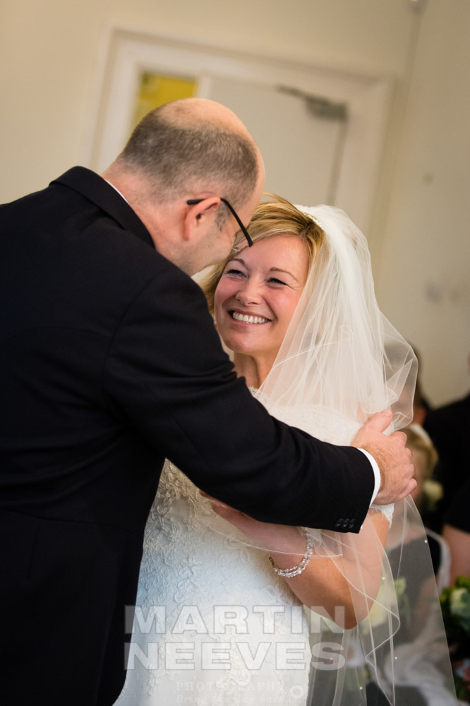 A loving embrace between the bride and groom.