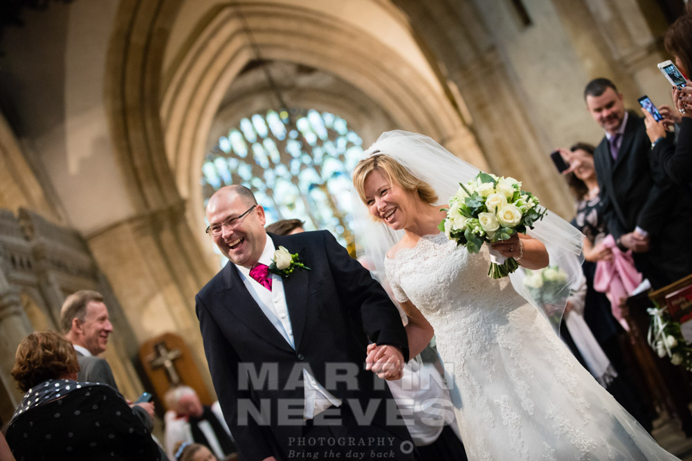 the happy couple walk back down the church aisle.