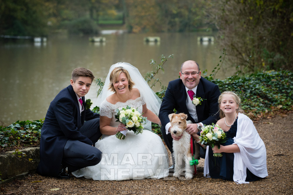 Portrait of the happy couple and their family.