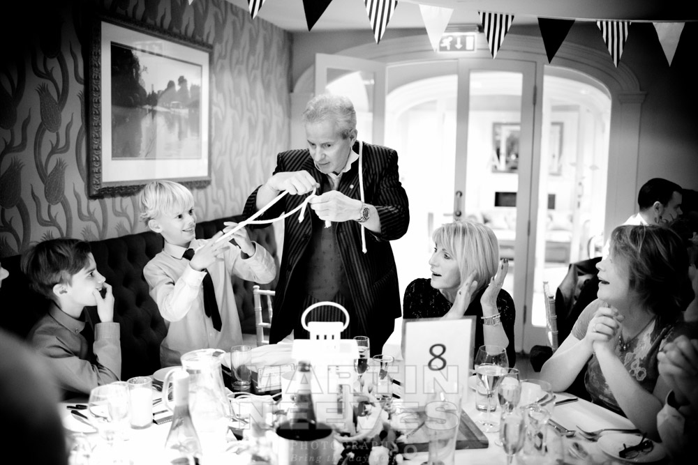 A magician entertains the wedding guests ion Stratford-upn-Avon, Warwickshire.