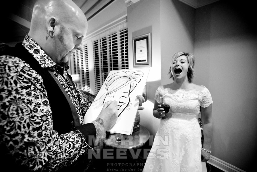 A caricaturist draws the bride.
