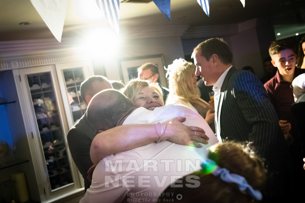 The happy couple embrace during the dancing.