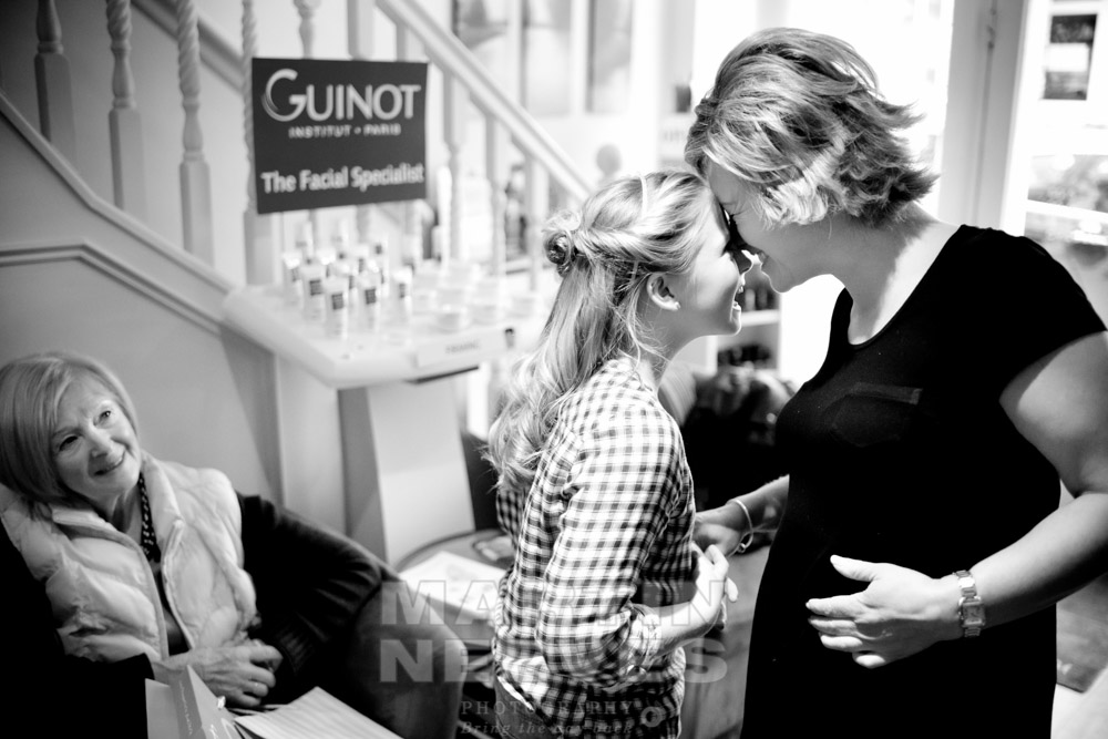 A loving moment between a bride and her daughter.
