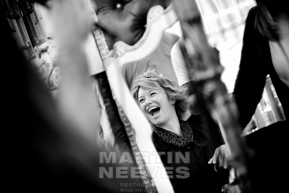 A selection of a laughing bride in the hairdressers window.